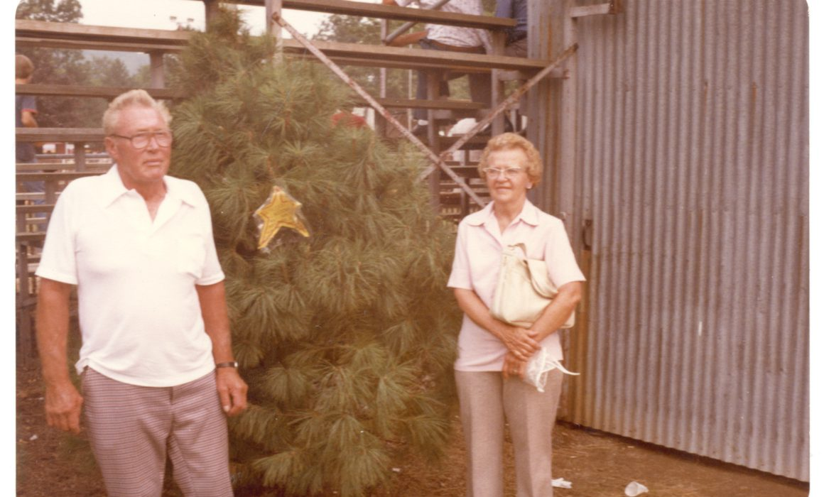 John and Dot Wyckoff standing next to pine tree